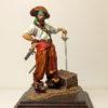 Пират с пистолетом и шпагой
